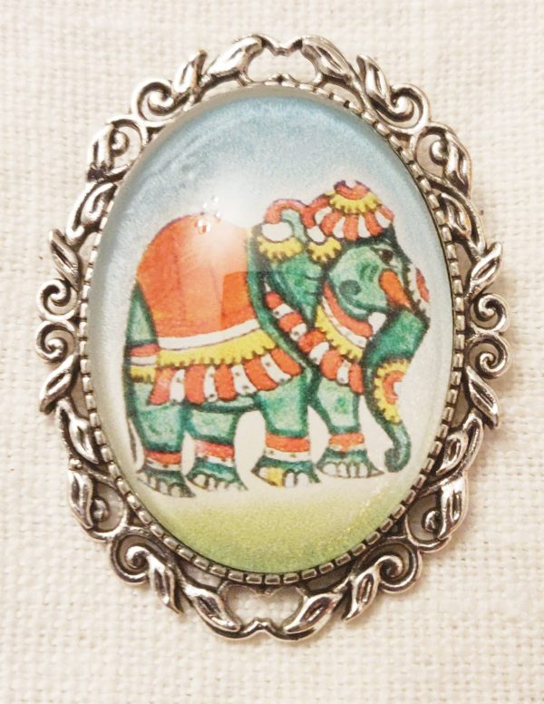 Broche verre éléphant argenté